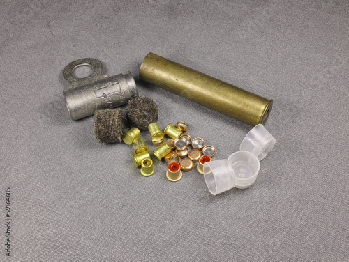 percussion caps and felt wad and brass shell for reloading