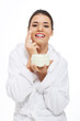 Beautiful woman in bathrobe with face cream.