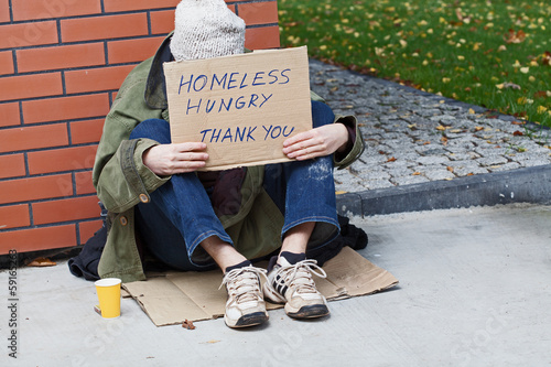Young homeless male begging for help