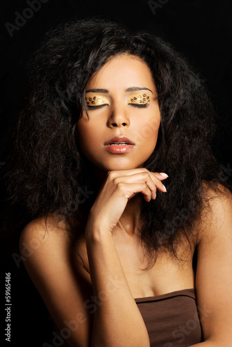 Beautiful mulatto woman with tiger make up.