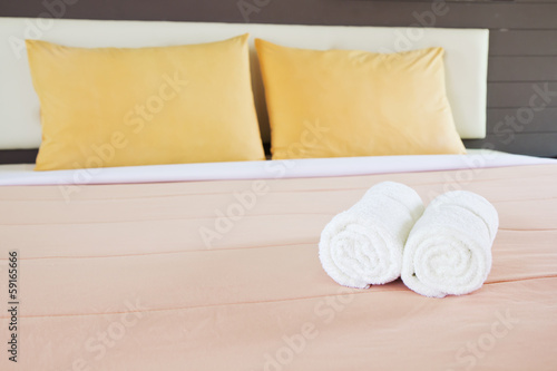 style bedroom interior with White towels and double yellow pillo