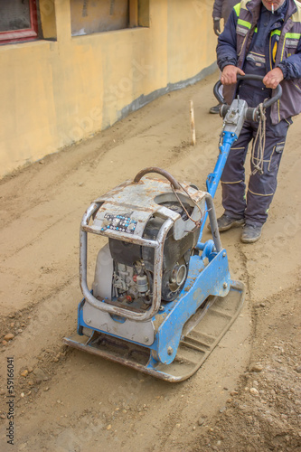 worker with vibrating plate compactor machine 2