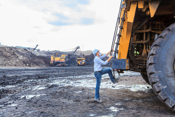 Worker BigTruck in Open Pit