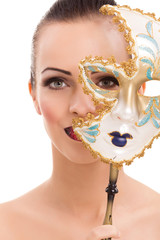 beautiful young woman with mysterious venetian mask
