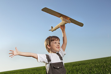 children with airplan toy outdoors