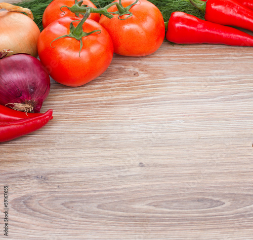 wooden board with  fresh vegetables