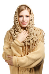 Smiling woman in warm comforter