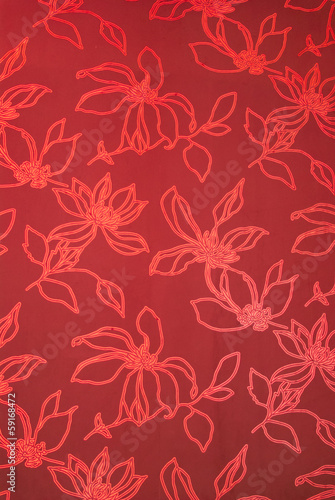 An exotic red color  floral pattern weaved fabric as textural