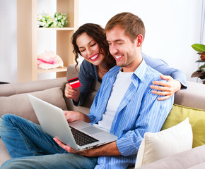 Online Shopping. Happy Couple Using Credit Card to Internet Shop
