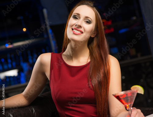 Portrait of an attractive woman in a nightclub