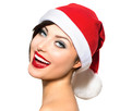 Christmas Woman. Beauty and Sexy Model Girl in Santa Hat