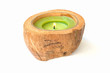 green Candle in a coconut shell