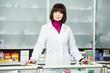 Pharmaceutical chemist woman in drugstore