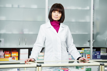 Pharmaceutical chemist woman in drugstore