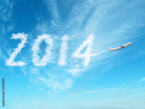 2014 with airplane on clouds sky
