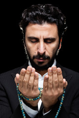 Western Muslim Praying with Tasbih