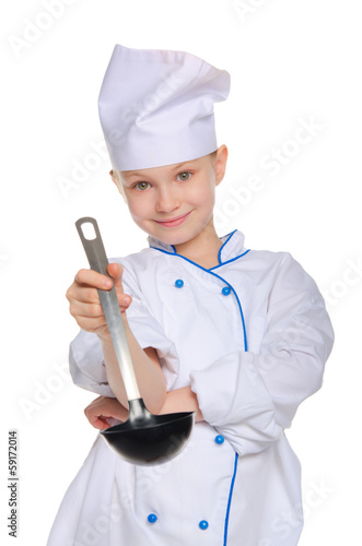 Young chef with a ladle