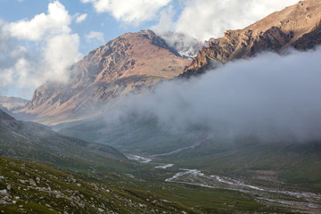 Mountain valley covered by clouds. Kyrgyzstan