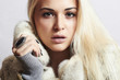 Beauty Fashion blond Model Girl in Mink Fur Coat. woman