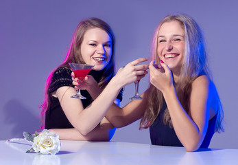 Female friends enjoying cocktails in a nightclub