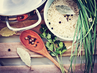 Healthy eating background with bowls of rice and spices