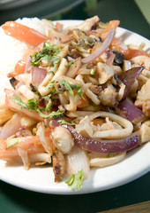 mariscos saltados Peruvian seafood fried in tomatoes onion  fren