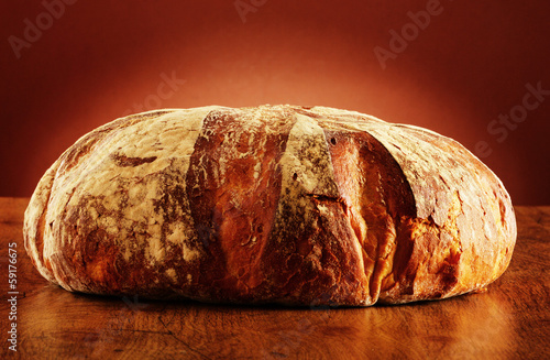 Large loaf of traditionally baked bread on the table