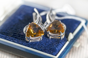 Silver earrings with citrine in a box