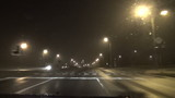 fast driving car on dense evening foggy street