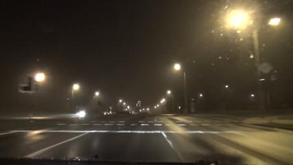 fast driving car on dense evening foggy street
