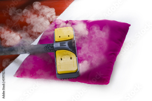 Dry steam cleaner in action. - 59178232