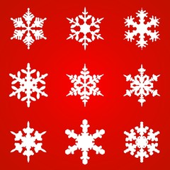 White snowflakes on red background seamless pattern for