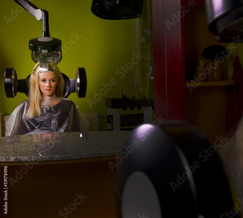 Blond woman in the hairdresser saloon.