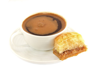 Cup of coffee with baklava cake