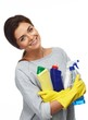 Beautiful  woman in gloves holding different cleaning stuff