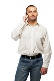 Handsome man in white shirt with mobile phone