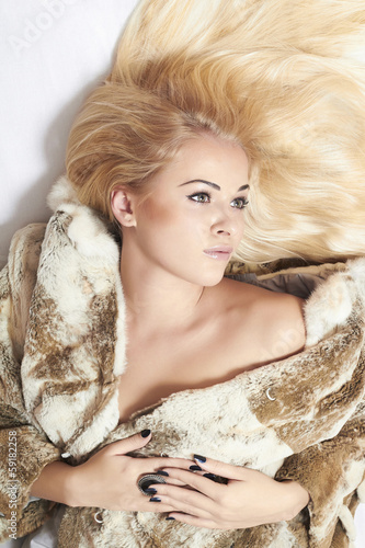 Beautiful blond woman in a fur.passion sexy woman.winter