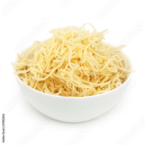 Staande foto Zuivelproducten Fromage rapé - Grated cheese
