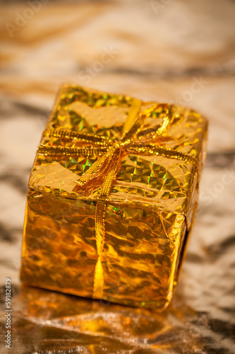 Decorative gifts on gold background