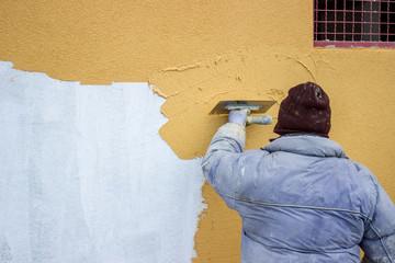 builder worker plastering facade 2