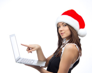 Christmas woman with laptop pointing monitor display