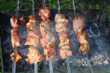 Delicious crispy appetizing barbecues grilled over burning coals