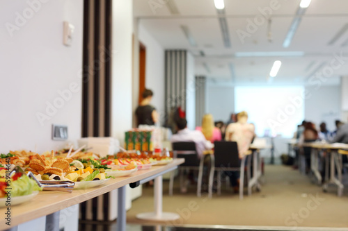 Tuinposter Voorgerecht Table with cold snacks and refreshments for business meeting