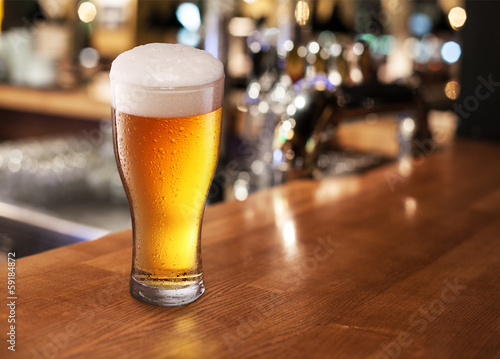 Beer glass on a bar.