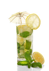 lass of cold mojito is decorated with umbrella