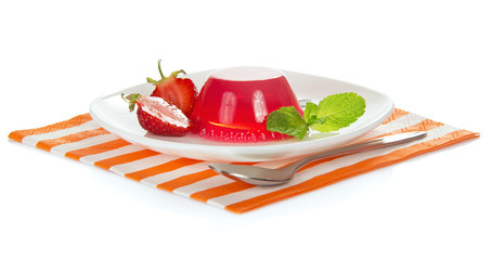 Plate with strawberry jelly on the striped napkin
