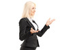 Businesswoman gesturing with hands, standing in profile