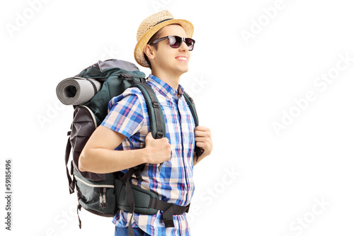 Male tourist with backpack walking