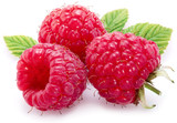 Raspberries with leaves isolated on a white.