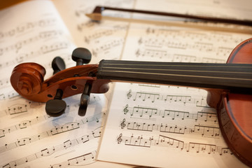 violin bow and notes